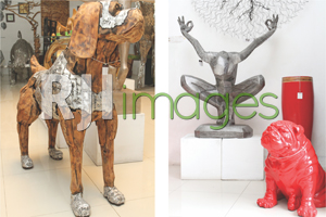Anjing dengan plat dan Karya seni patung logam